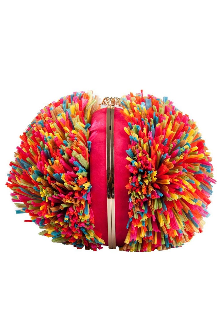 Embrace the fun and peppy side of you with this chic, fun and eye-catching Charlotte Olympia Fiesta clutch bag. It is designed with satin and multicolors straws creating an intriguing silhouette. It features a long chain-link shoulder strap and an