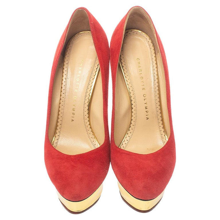 You are sure to impress everyone whenever you step out in these pumps from Charlotte Olympia! Crafted out of suede in an enticing red shade and lined with leather on the insoles, this number is from their Dolly collection. They've been beautified