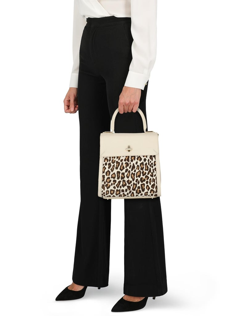 Bogart Fall 2014 Bag, leather, animal print, internal logo, pony, turn-lock closure, gold-tone hardware, external pocket, internal slip pocket, internal zipped pocket, removable internal pouch, day bag  Includes: - Shoulder strap  Product Condition: