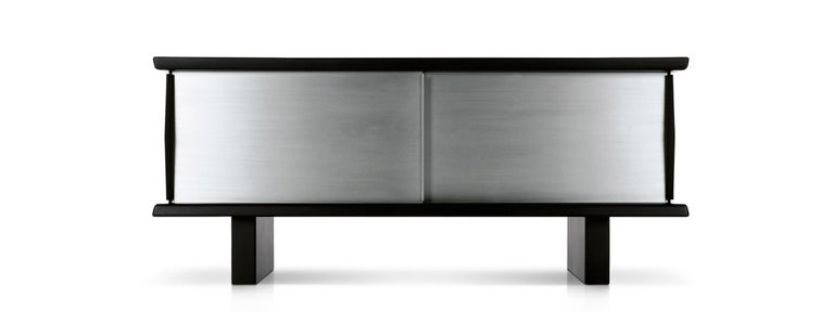 Storage unit designed by Charlotte Perriand in 1939. Relaunched in 2014. Manufactured by Cassina in Italy.  Part of the Cassina collection since 2004, the Riflesso storage unit created in 1958 by Charlotte Perriand in association with Steph Simon