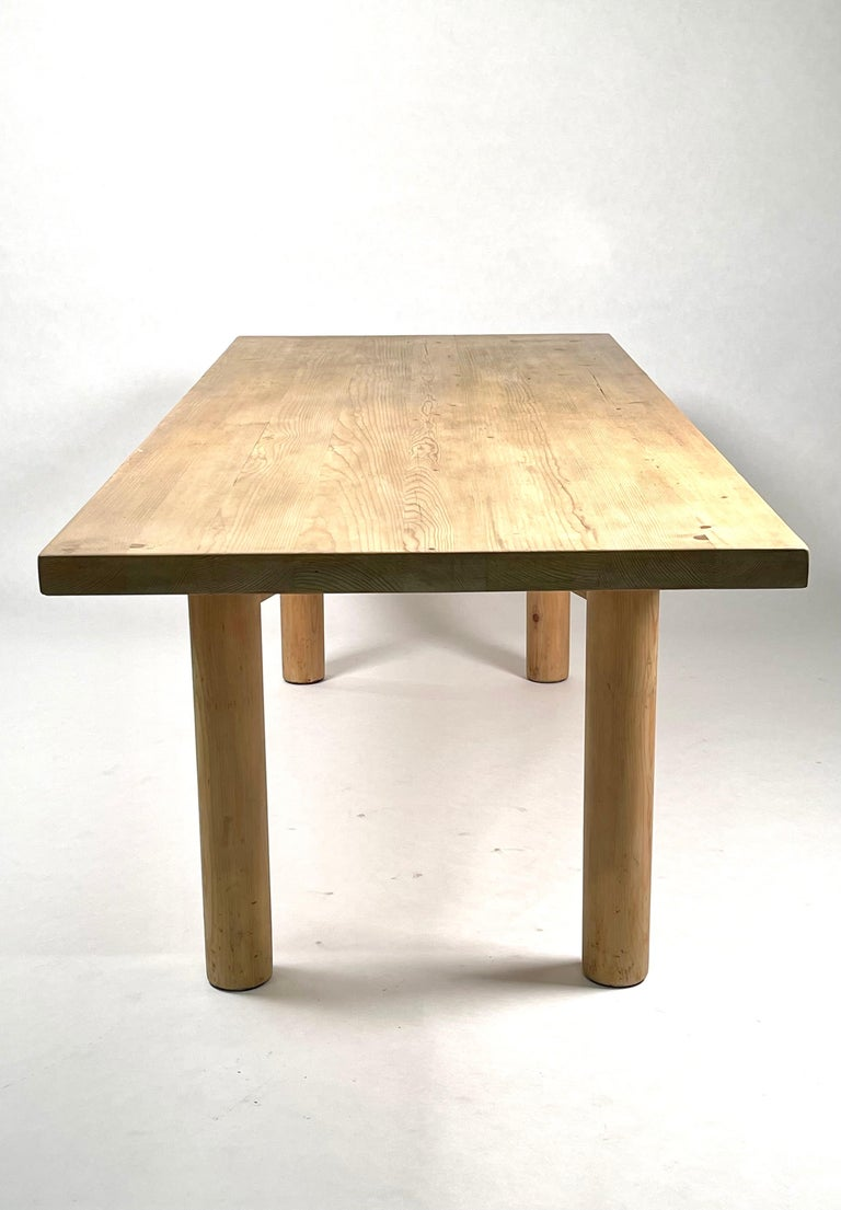 A large & rare dining table in solid acid stained pine. Designed by Charlotte Perriand for the Méribel Ski resort. Executed by René Martin, one of Charlotte Perriand's two cabinetmakers in Méribel-les-Allues, France, 1950. The table has received