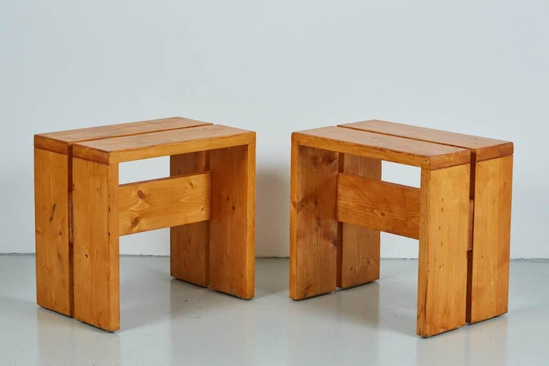Pair of pine stools designed by Charlotte Perriand for Les Arcs Ski Lodge. Fantastic pair with great original patina. 2 sets available - priced per pair