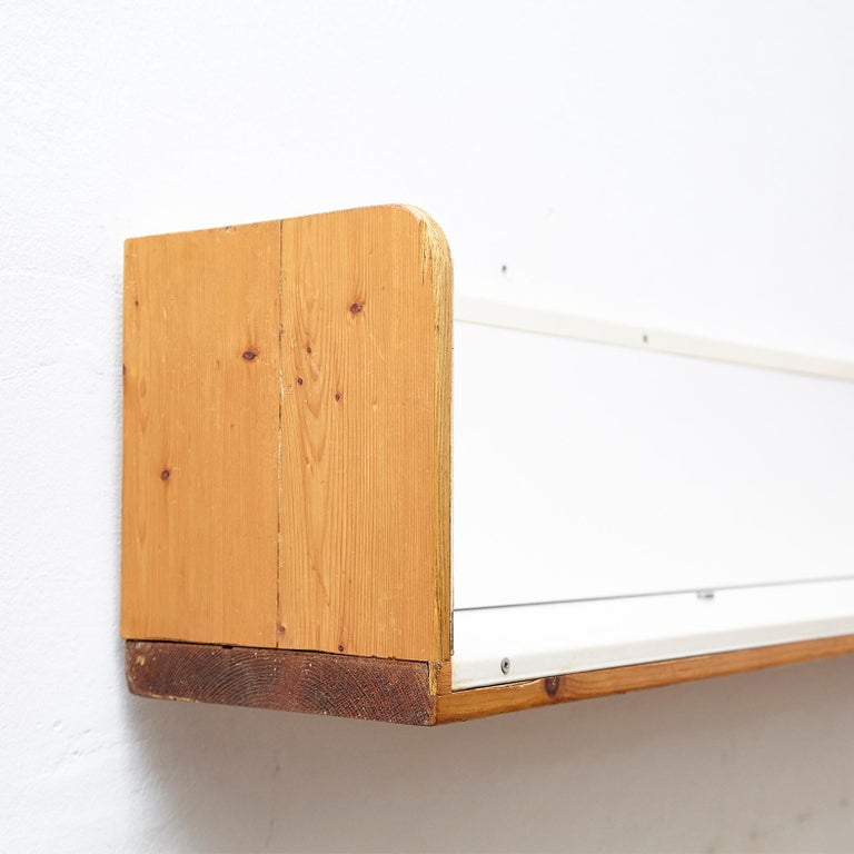 Shelve designed by Charlotte Perriand for Les Arcs, circa 1960, manufactured in France. Pinewood and metal.  In good original condition, with minor wear consistent with age and use, preserving a beautiful patina.  Charlotte Perriand