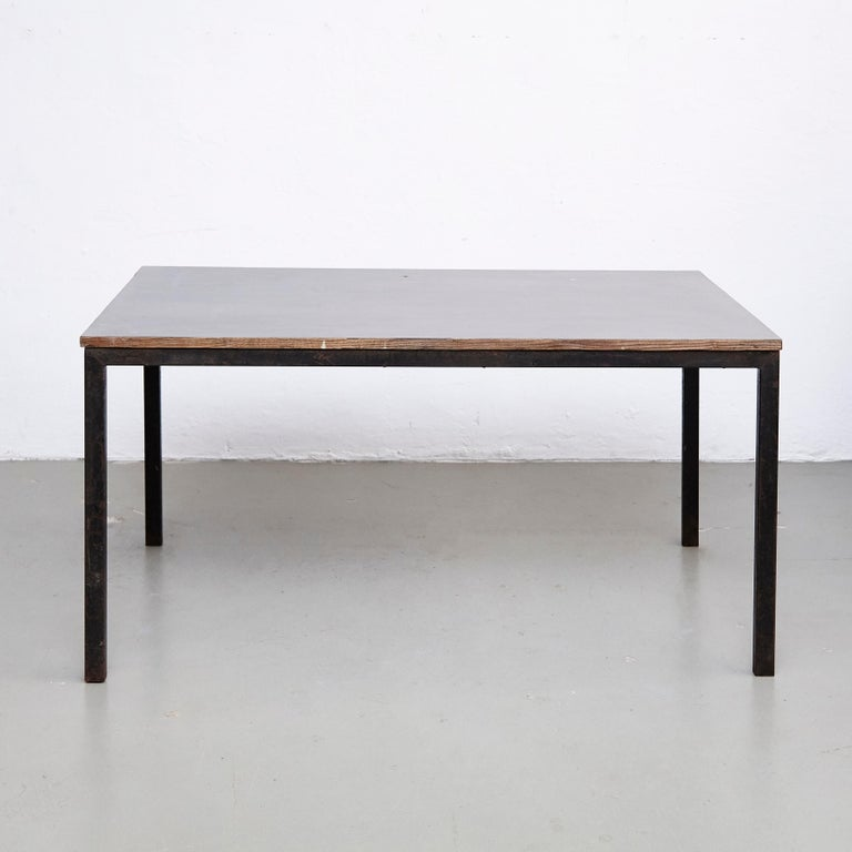 Table designed by Charlotte Perriand, circa 1950.  Wood, metal frame legs.  Provenance: Cansado, Mauritania (Africa).  In good original condition, with minor wear consistent with age and use, preserving a beautiful patina.   Charlotte