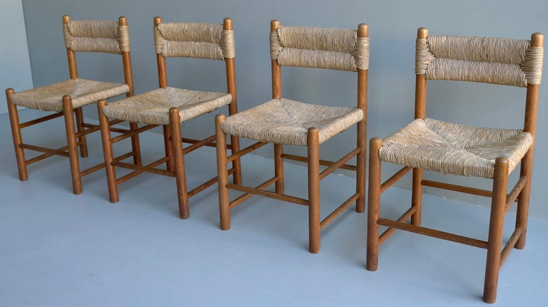Charlotte Perriand, set of four cane and wood