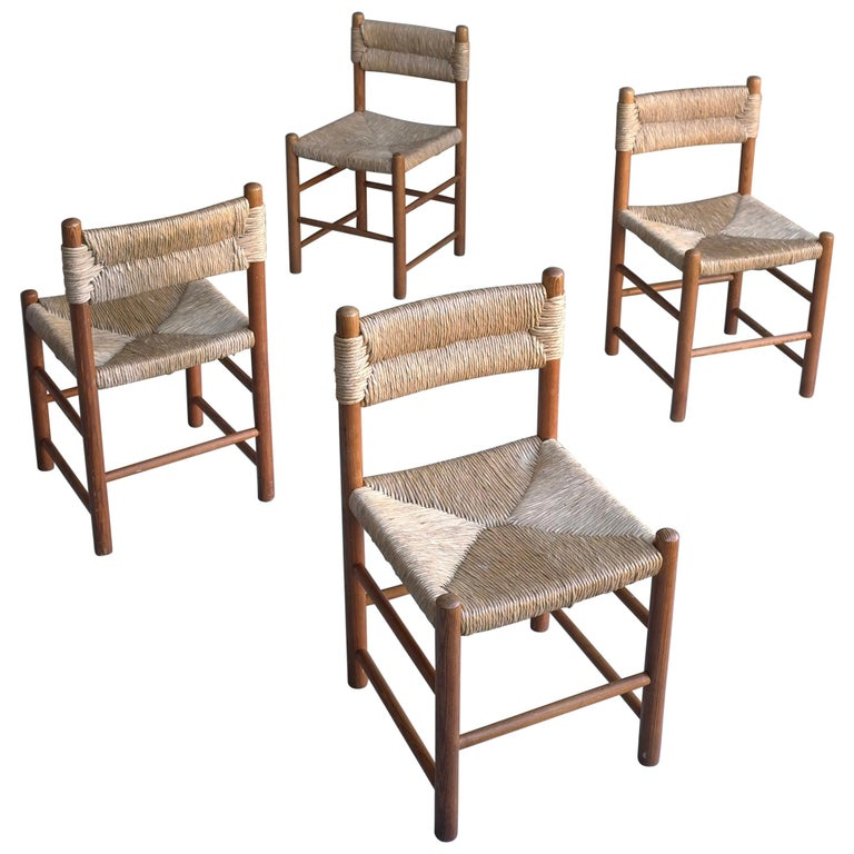 "Charlotte Perriand, Set of Four Rush and wood ""Dordogne"" Chairs, France, 1960s For Sale"