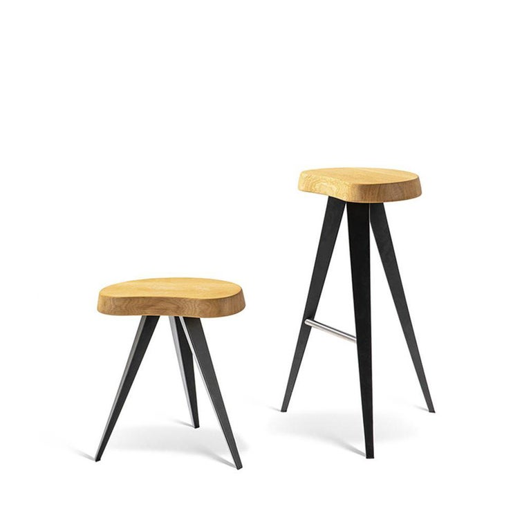 Set of two stools designed by Charlotte Perriand in 1952-56. Relaunched by Cassina in 2019. Manufactured by Cassina in Italy.  In addition to the new table versions (dining, two new low table heights and a bar version), the Mexique family is now