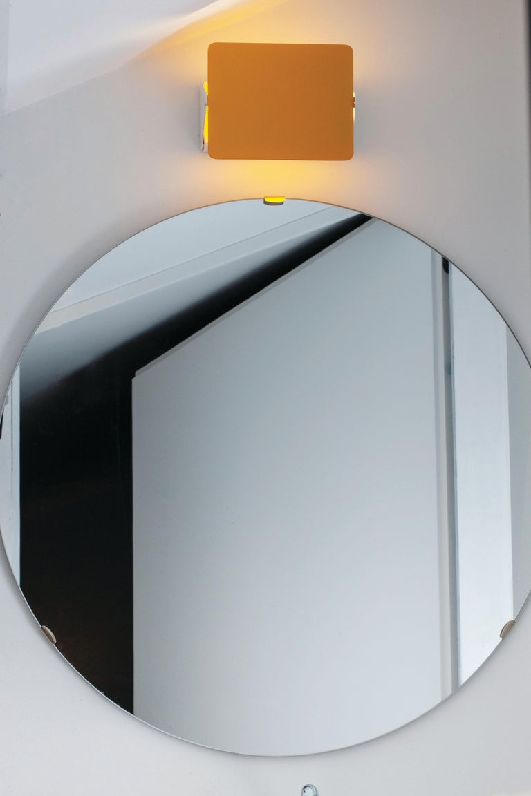 Charlotte Perriand 'Applique Á Volet Pivotant' Wall Lights in Yellow. A clean and iconic design executed in yellow and white painted metal. Originally designed in the 1950s as the iconic CP1, these newly produced authorized re-editions are still