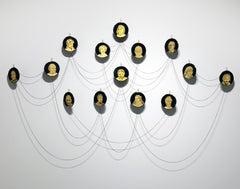 """Gilded Saints"" gold leaf hand engraved glass cameo portraits"