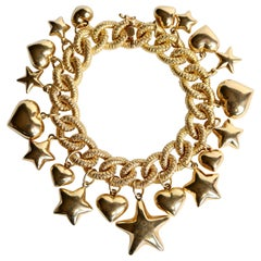 Charm Bracelet in 18 Karat Yellow Gold Hearts, Stars