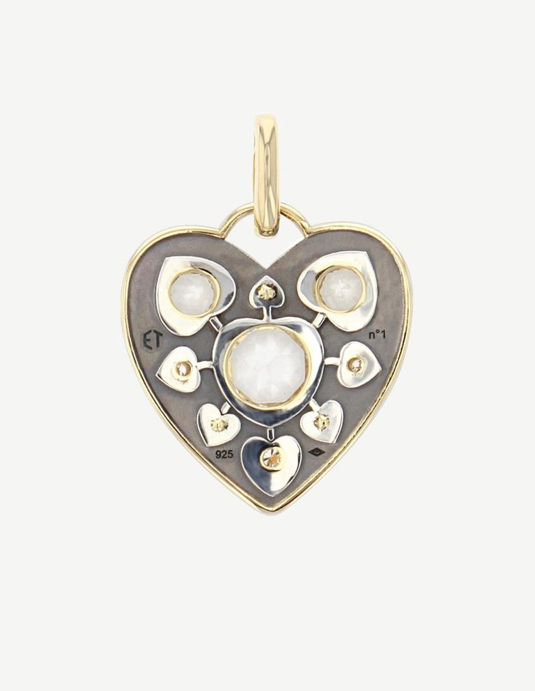 Topaz 3 Diamonds :0,14ct Yellow Gold : 4.5 g Distressed Silver : 3g Dimensions: 26 x 26 mm Made in France  Heart-shaped Charm made out of yellow gold and distressed silver. Set with topaz and diamonds.  Sold without chain. Chain on request.
