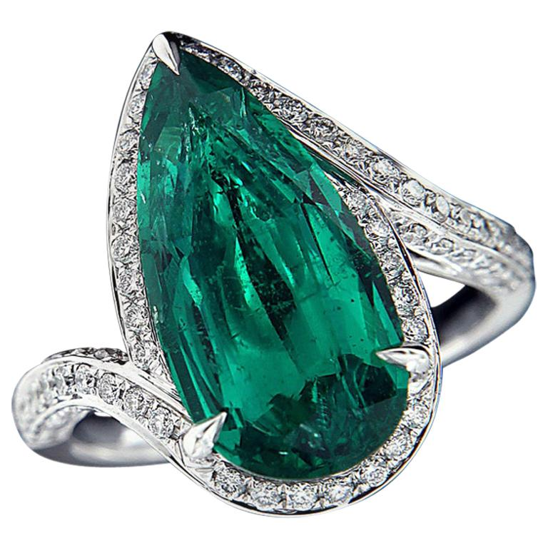 Charming 18 Karat White Gold, Diamond, and Emerald Ring