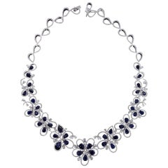 Charming 18 Karat White Gold, Diamond and Sapphire Necklace