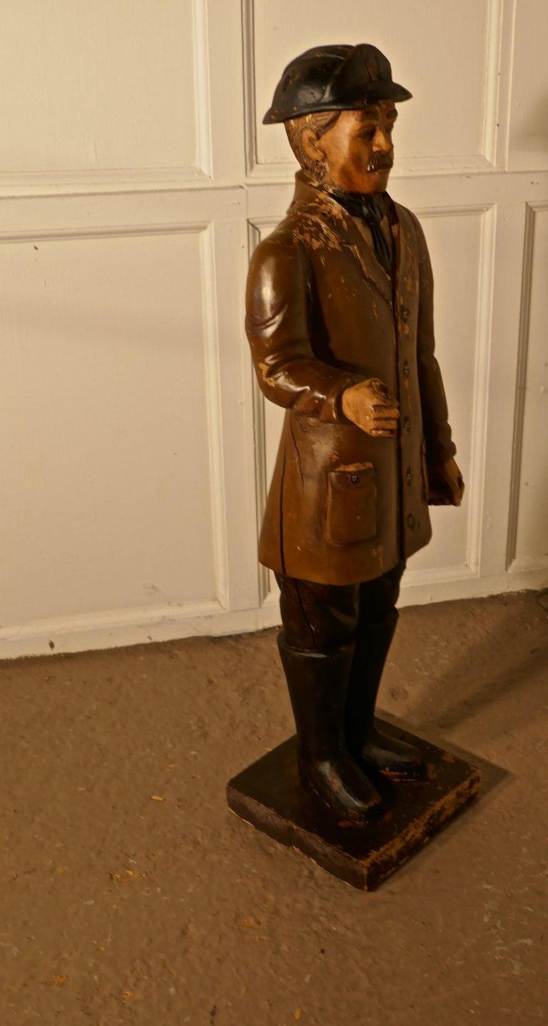 Folk Art Charming 1920s Wooden Fireman Sculpture For Sale