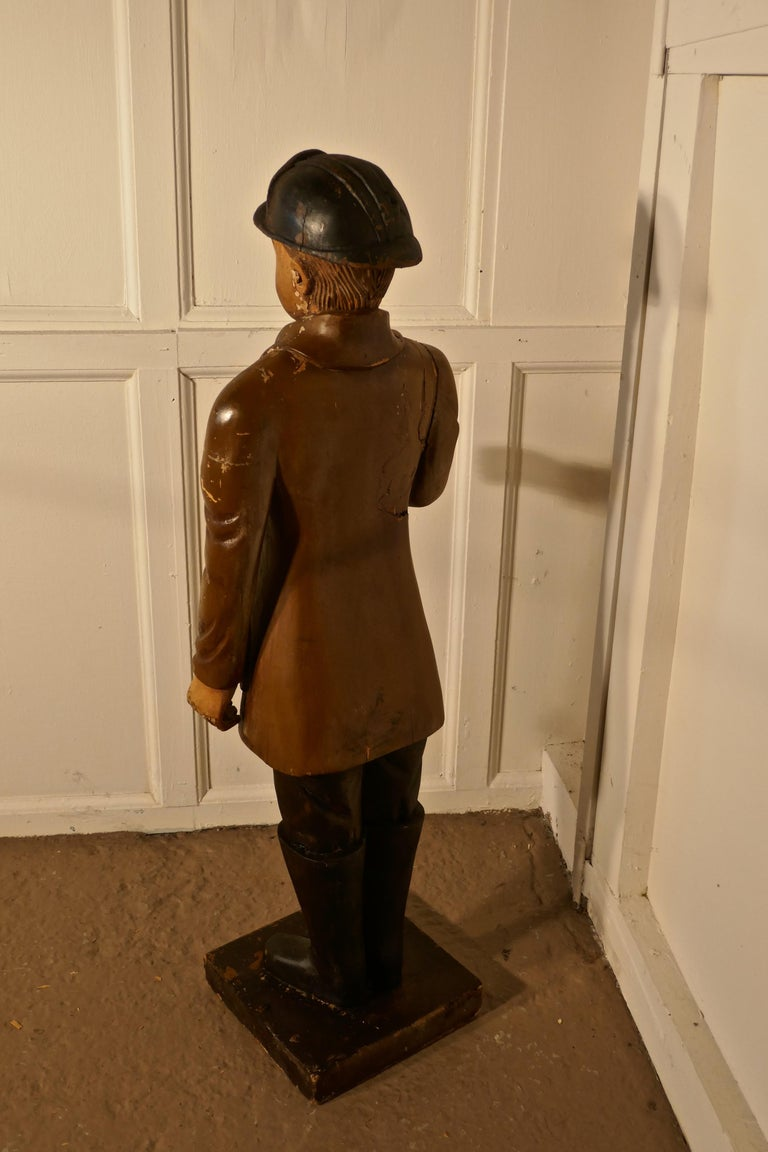 20th Century Charming 1920s Wooden Fireman Sculpture For Sale