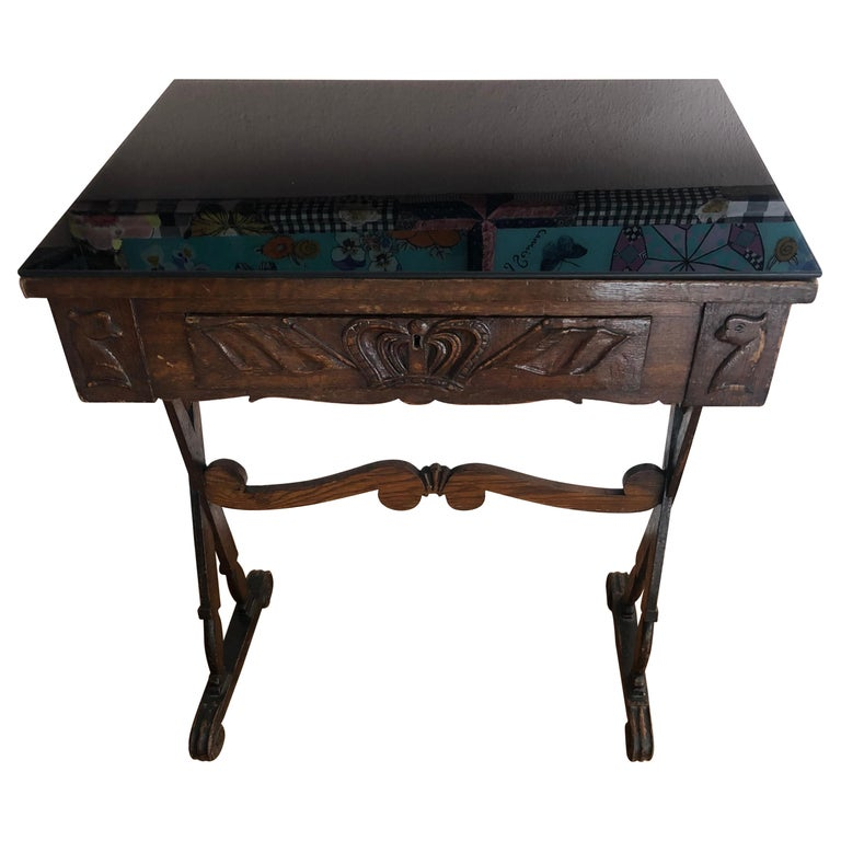 Charming Antique English Carved Oak End Table with Crown and Black Glass Top For Sale