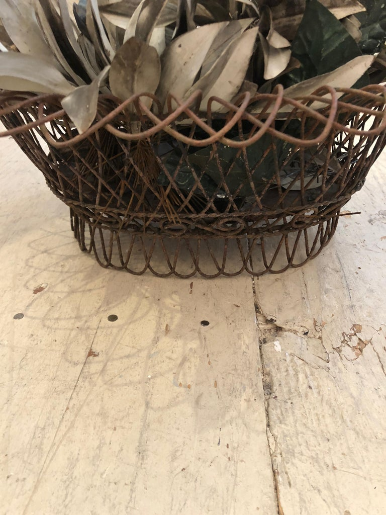 Wonderful tabletop accessory that's a 19th century wire and metal basket planter, filled with tole leaves in a gunmetal grey.