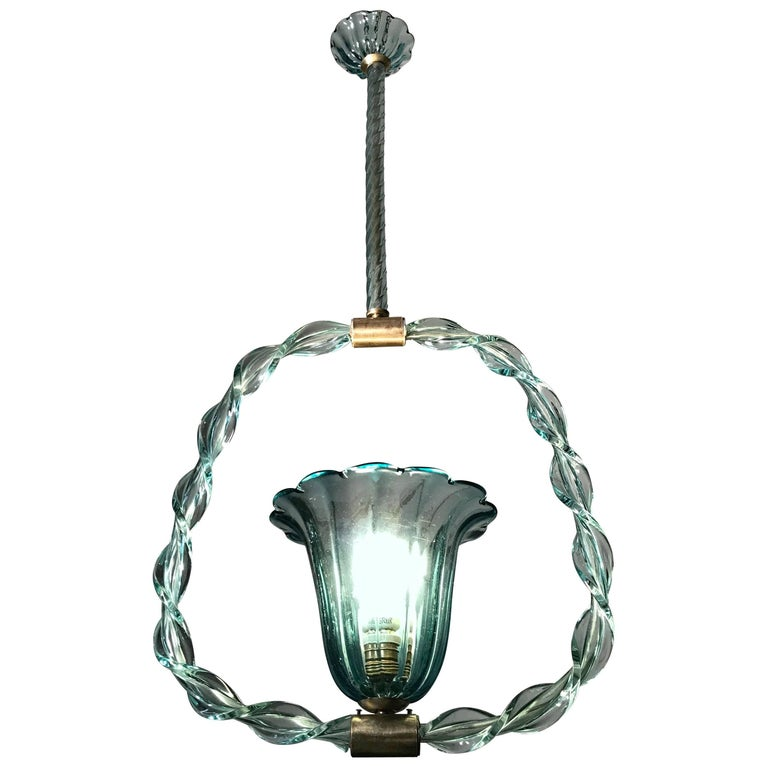Rare beauty 'Aquamarine' colored glass chandelier by Ercole Barovier, 1940s.  Brass with original patina.  Single light socket E27. We can wire for US standards.