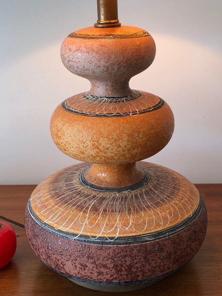 An interesting ceramic gourd lamp with sgraffito decoration and original shade. Total height with shade is approx. 30