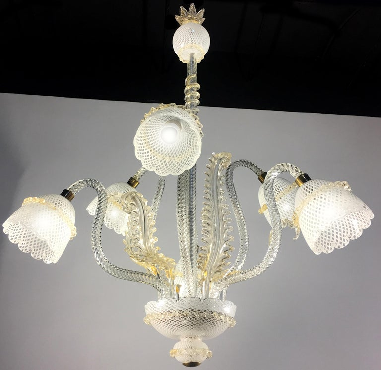 Six-arm chandelier gold inclusions, Italy. Hand blown glass using the 'Reticello' technique.