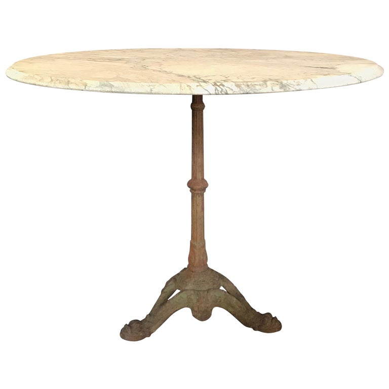 Charming French Cafe Bistro Table with Marble Top and Beautiful Dolphin Feet For Sale
