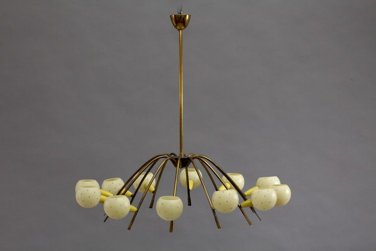 Big Italian Sputnik chandelier attributed Stilnovo, Italy, 1950. 12 brass arms, enameled cones, round glass shades with little black dots. Measures: Height 100cm, diameter 100cm.