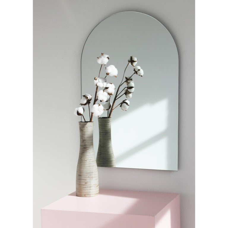 Delightful handcrafted silver mirror frameless. Available with a bronze or black tint; please contact us for a quote.  One mirror, multiple positions. Fully fitted with specialist plates to easily hang in one of four directions.  Measures: W 460 x H