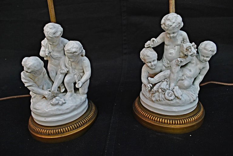 A real cute and charming pair of cherubs porcelain table lamps, the details are much nicer in person.