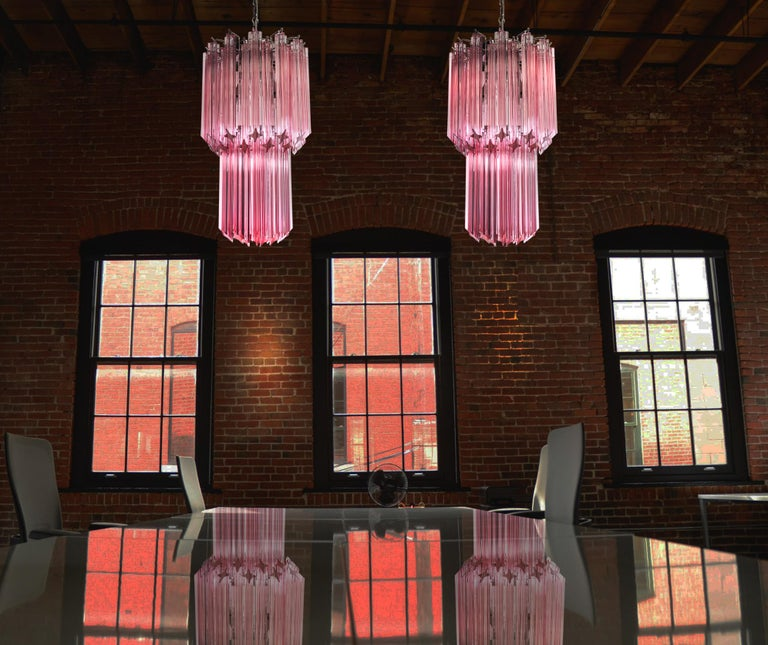 Pair of fantastic vintage Murano chandeliers made by 46 Murano crystal pink prism in a nickel metal frame. Period: late 20th century Dimensions: 55.10 inches height (140 cm) with chain; 27.50 inches height (70 cm) without chain; 12.6 inches