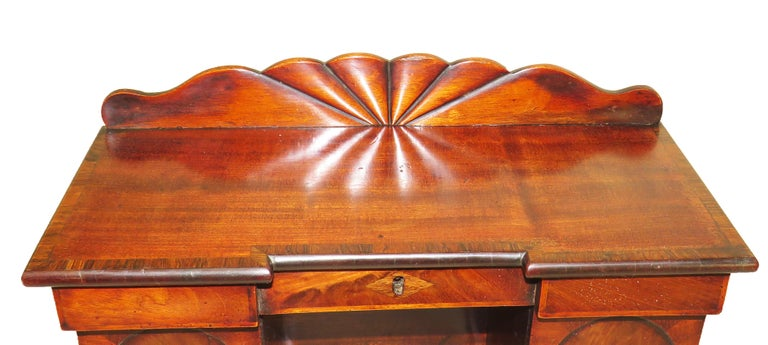 A delightful and rare early 19th century mahogany tea Caddy in the form of a miniature pedestal sideboard Having well figured and crossbanded hinged top over Concealed removable tea canisters raised on Original plinth base  (This rare, elegant