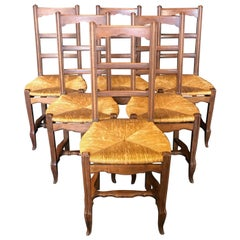 Charming Set of Six French Provincial Walnut Dining Chairs with Rush Seats