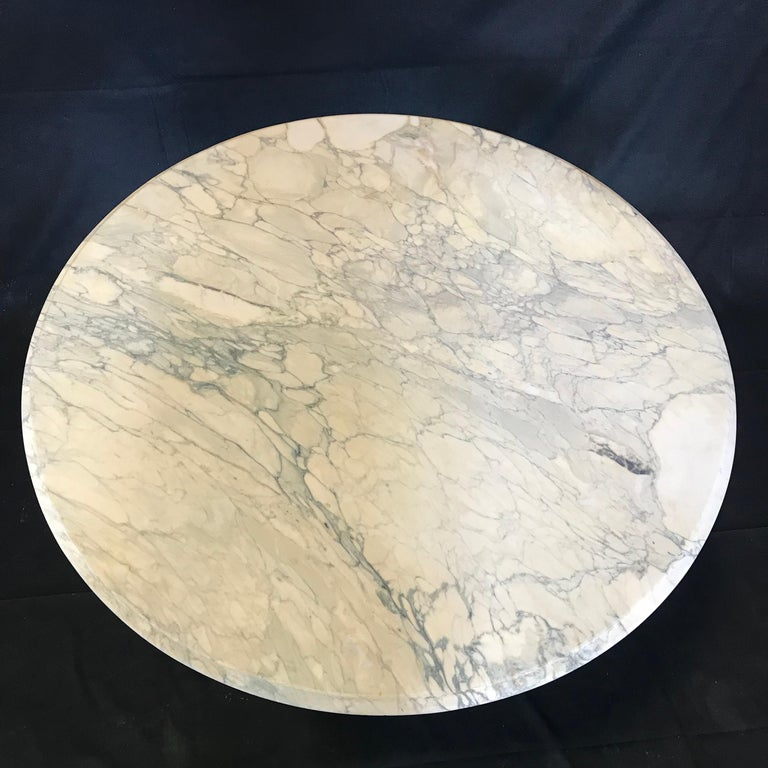 French cafe or bistro table having beautiful white Carrara marble top and dolphin feet on metal pedestal base - perfect for dining indoor or outdoors!