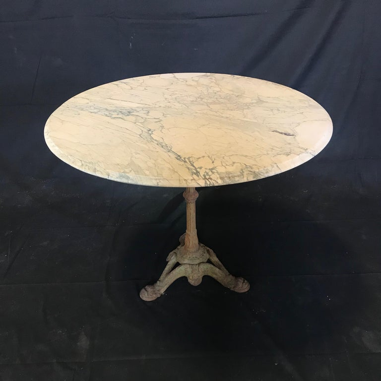 Early 20th Century Charming French Cafe Bistro Table with Marble Top and Beautiful Dolphin Feet For Sale