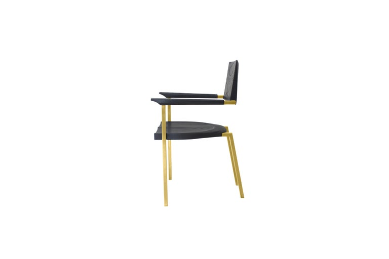 This chair evokes a feeling of solidity, weight and forward movement. Notable features are the