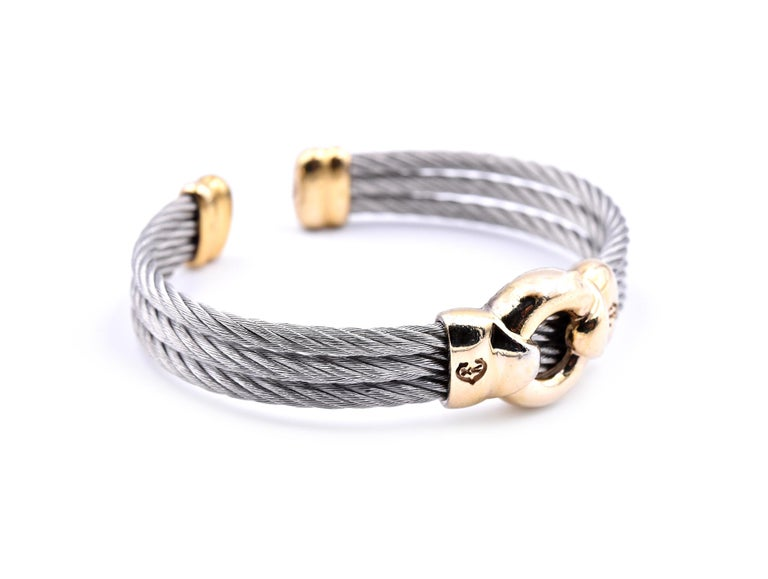 Designer: custom design Material: 14k yellow gold and stainless steel Dimensions: cuff bracelet will fit a 6 ½-inch wrist and it is 9.45mm-16.20mm wide Weight: 31.8 grams