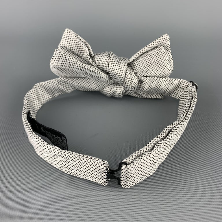 CHARVET bow tie comes in black and white print silk with an adjustable neck. Made in France.  Excellent Pre-Owned Condition.   Original Retail Price: $250.00