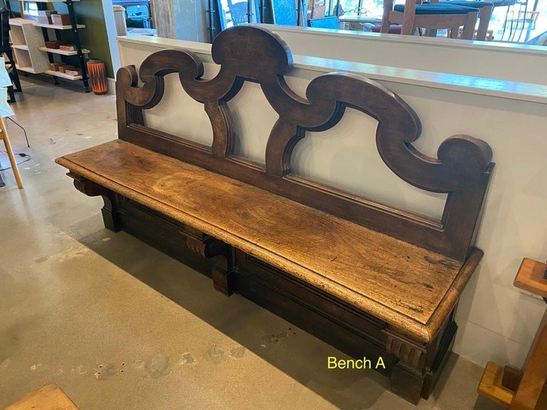 Handmade bench with ornate back of solid hardwood. Two available. Sold separately. France, 18th century. Dimensions of Bench A are included in listing. Dimensions of Bench B: D 20.25