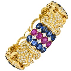 Chatila 32.85 Carat Ruby Sapphire Diamond 18 Karat Gold Fluer-de-Lis Bracelet