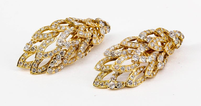 Elegant diamond and 18K yellow gold earrings by Chaumet. They are made in the likeness of wings, with flexible moving parts. Diamonds are high grade round brilliant cut, approx. 5-6 carats total weight,  over a yellow 18K gold setting.   Hallmarks: