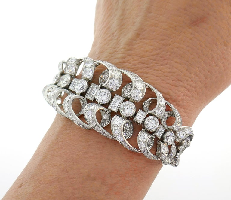 Stunning late Art Deco bracelet created by Chaumet, Paris in the 1930s. It is made of platinum and set with transitional round brilliant cut and baguette cut diamonds. The diamonds are of F-G-H color VS clarity, total weight is approximately 18.50