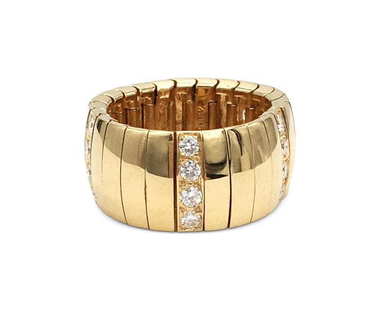 Authentic Chaumet flexible ring crafted in 18 karat yellow gold featuring five sections of high-quality round brilliant cut diamonds weighing an estimated 0.60 carats total. Signed Chaumet, 750, with serial number and hallmarks. Ring size 8. The