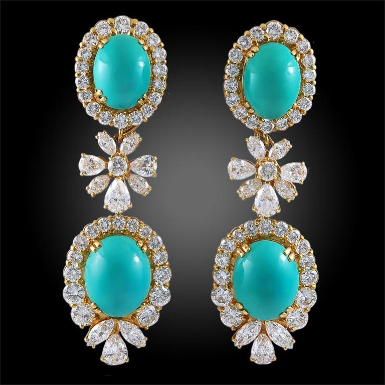 A remarkable suite comprising a necklace and ear clips by Chaumet that dates back to the 1970s. The necklace is exquisitely set with graduated cabochon turquoises framed by high-quality brilliant-cut diamonds, interspersed by brilliant-cut,