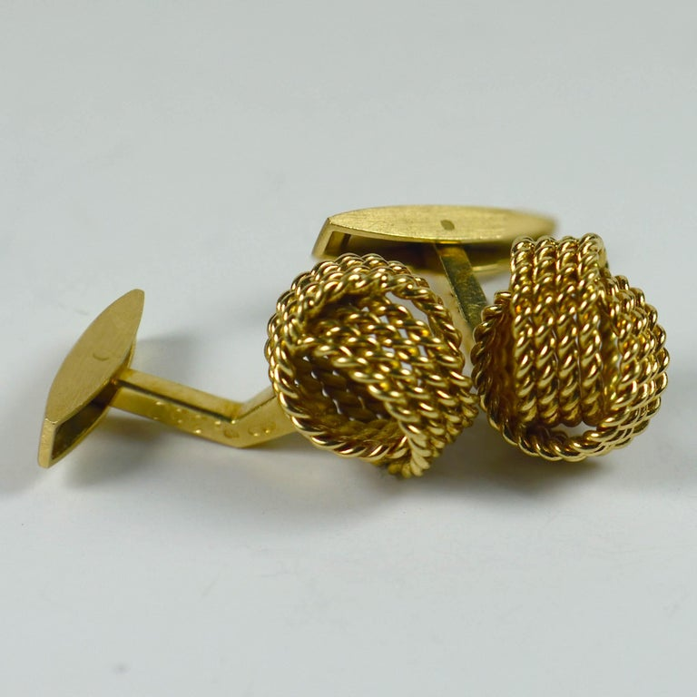 A smart pair of 18 karat gold twisted rope knot cufflinks by Chaumet Paris. Signed CHAUMET, numbered and stamped with French marks. 1.25