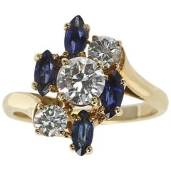 Chaumet, Paris Marquise Sapphire and Round Diamond Ring, 18 Karat Yellow Gold