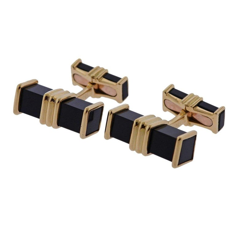 Pair of French 18k gold cufflinks, crafted by Chaumet, set with onyx (tiny chip on one of the onyx, on the back). Cufflink top - 20mm x 7mm, back - 15mm x 5mm, Cufflinks weigh 16.1 grams. Marked Chaumet, Paris, 1304 G, French gold assay marks.