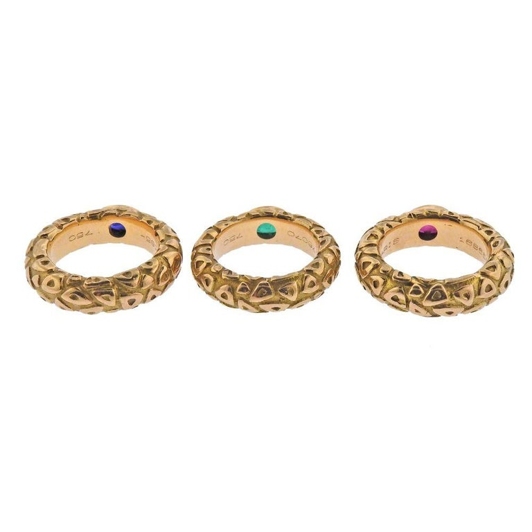 Set of 3 stackable 18k gold band rings by Chaumet Paris, with ruby, emerald and sapphire.   Each ring size - 4.5-4.75, each is 6mm wide. Weight - 26.7 grams. Marked: Chaumet Paris, 176070.