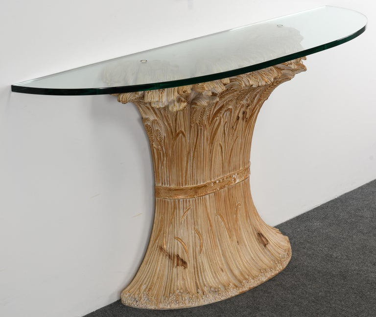 A hand carved Italian wheat sheaf console table by Chelini. This fabulous console has beautiful carvings with a parcel gold gilt accent. Some minor wear to gilt decoration, but overall in good condition. Minor scratches to glass but not