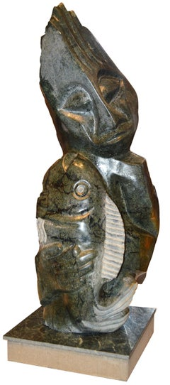 'Special Catch' stone Shona sculpture figure and fish signed by Chemedu Jemali