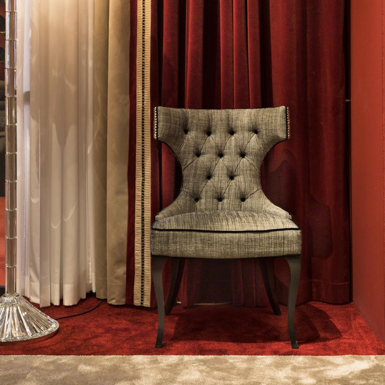 An exquisite example of masterful craftsmanship and classic design reinterpreted with a contemporary flair, this chair will be a perfect complement to one of the tables in this collection, or a charming accent piece in a living room or entryway. The