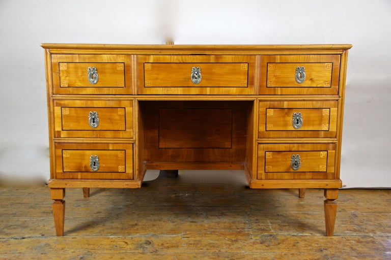 Splendid cherrywood writing desk with kneehole from the late 18th century in Austria, circa 1790. This over 220 year old writing desk from the so-called